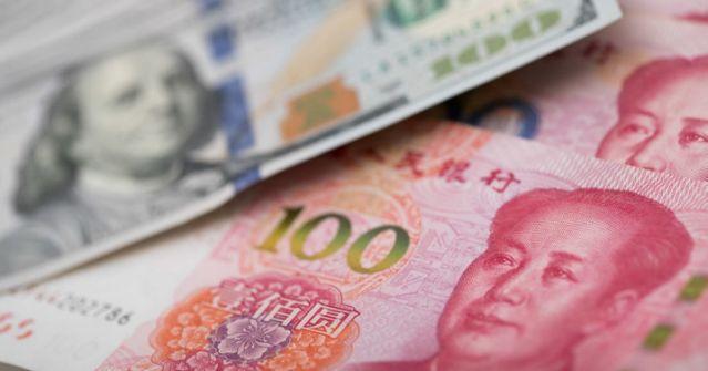 Trung Quốc thiết lập tỷ giá tham chiếu ở mức 7.0312/ 1 USD- mạnh hơn dự kiến - dong nhan dan te 6 5 1020937 thumb