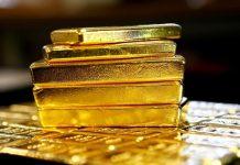 Vàng tăng nhưng đà tăng bị hạn chế khi đồng Đô la và lợi tức trái phiếu Mỹ tăng